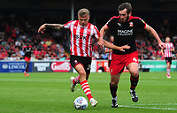 Lincoln City's Harry Anderson vies for possession with Swindon Town's Jak McCourt<br /> <br /> Photographer Chris Vaughan/CameraSport<br /> <br /> The EFL Sky Bet League Two - Lincoln City v Swindon Town - Saturday 11th August 2018 - Sincil Bank - Lincoln<br /> <br /> World Copyright &copy; 2018 CameraSport. All rights reserved. 43 Linden Ave. Countesthorpe. Leicester. England. LE8 5PG - Tel: +44 (0) 116 277 4147 - admin@camerasport.com - www.camerasport.com