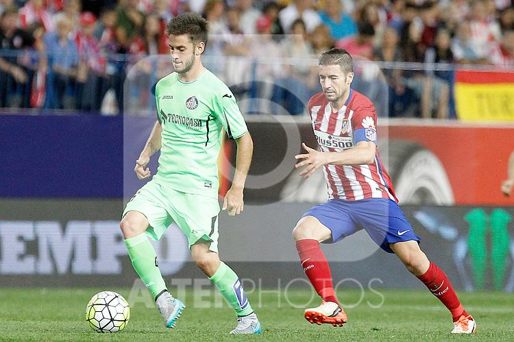 Atletico de Madrid's Gabi Fernandez (r) and Getafe's Victor Rodriguez during La Liga match.September 22,2015. (ALTERPHOTOS/Acero)