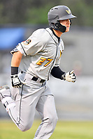 West Virginia Power left fielder Ryan Ramiz (27) runs to first base during a game against the Asheville Tourists at McCormick Field on April 18, 2019 in Asheville, North Carolina. The Power defeated the Tourists 12-7. (Tony Farlow/Four Seam Images)