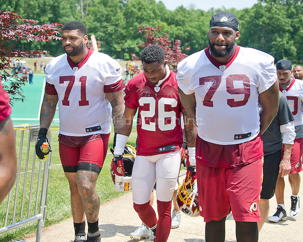 Washington Redskins offensive tackle Trent Williams (71), cornerback Bashaud Breeland (26), and offensive tackle Ty Nsekhe (79) leave the field following an organized team activity (OTA) at Redskins Park in Ashburn, Virginia on Wednesday, June 1, 2016.<br /> Credit: Ron Sachs / CNP/MediaPunch ***FOR EDITORIAL USE ONLY***