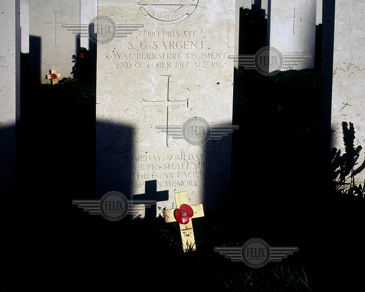 A remembrance poppy on the grave of a British soldier in Tyne Cot, the biggest Commonwealth War Cemetery in the world where almost 12,000 men, killed in the Ypres Salient during World War I, are laid to rest.