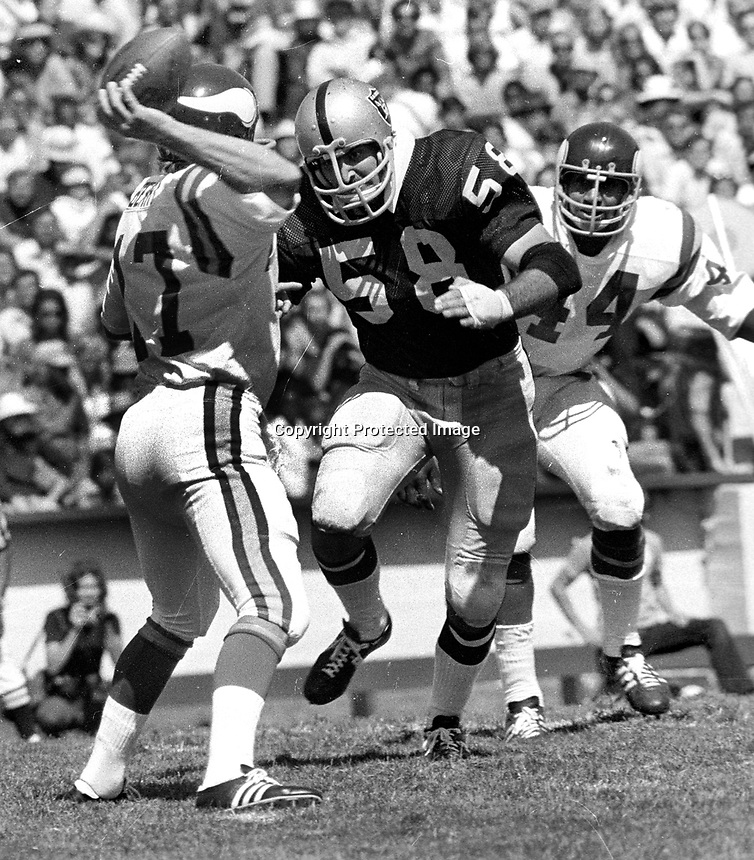 St. Louis Cardinal QB Jim Hart rushed by Oakland Raider Linebacker Monte Johnson. (1973 photo/Ron Riesterer)