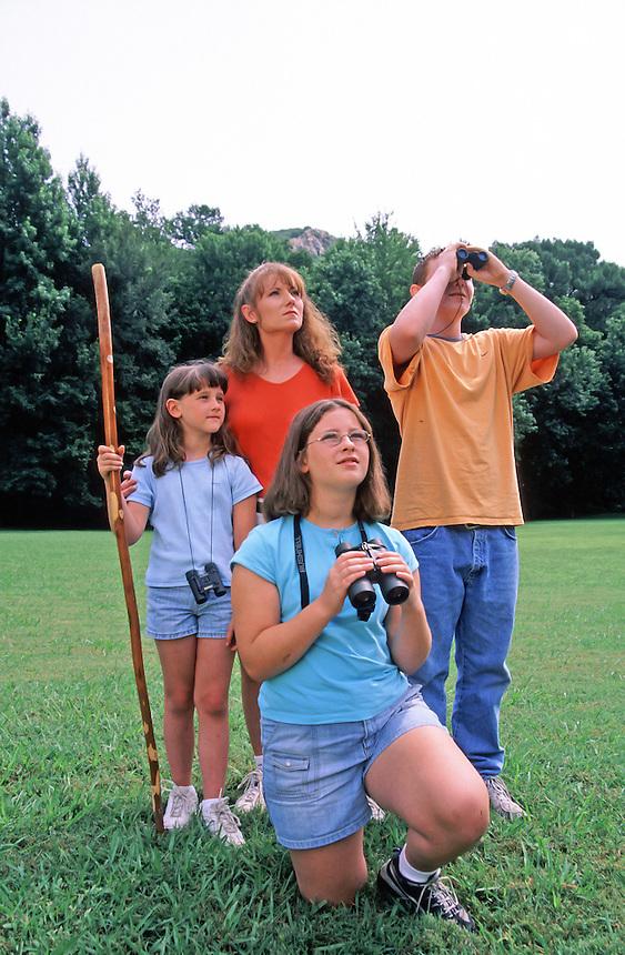 Family birdwatching at Pinnacle Mountain State Park, Arkansas.