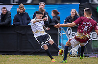 Dappy (Musician / Celebrity Big Brother) shoots at goal past Scott Saunders (The Apprentice 2015) during the SOCCER SIX Celebrity Football Event at the Queen Elizabeth Olympic Park, London, England on 26 March 2016. Photo by Andy Rowland.