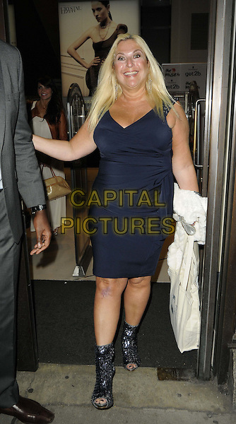 Vanessa Feltz.The Muse.tv launch party, Swarovski Crystallized Lounge, Great Marlborough St., London, England..February 28th, 2012.full length black open toe sparkly boots dress sleeveless blue goody bag  .CAP/CAN.©Can Nguyen/Capital Pictures.