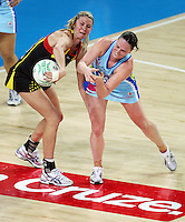 28.06.2010 Magic's Casey Williams and Steels Megan Dehn in action during the ANZ Champs Semi Final netball match between the Magic and Steel played at Vector Arena in Auckland. ©MBPHOTO/Michael Bradley