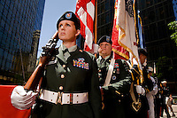 Army soldiers stand at attention prior to presenting the colors during Food Lion Speed Street in uptown Charlotte, NC.
