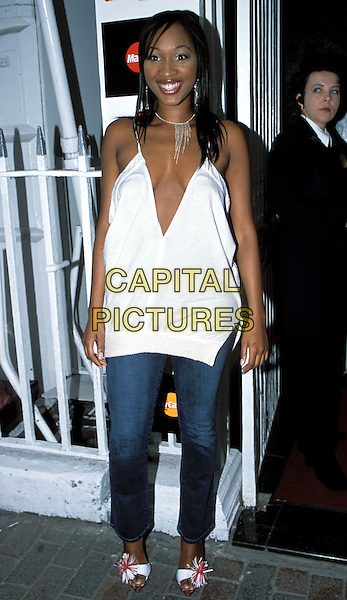 TERRI WALKER.MOBO Awards 2003 launch party at Tantra Club.www.capitalpictures.com.sales@capitalpictures.com.© Capital Pictures.plunging neckline, white v-shape top, denim jeans.
