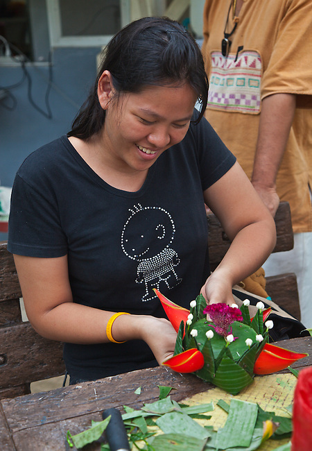 A Thai volunteer makes a Loi Krathong float during the festival at the HOME AND LIFE ORPHANAGE in PHANGNGA - KHAO LOK, THAILAND