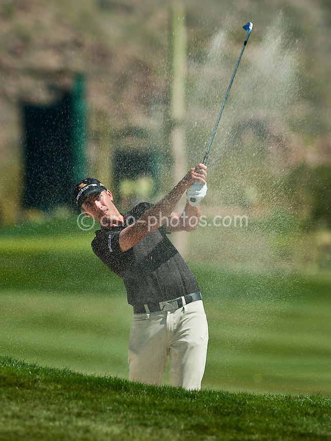 Mar 1, 2009; Marana, AZ, USA; Geoff Ogilvy (AUS) hits out of a bunker on the 2nd fairway during the final round of the World Golf Championships-Accenture Match Play Championship at the Ritz-Carlton Golf Club, Dove Mountain.  The win this week brought Ogilvy's career record in this event to 17-2 with two victories.
