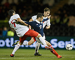 Tony Watt held back on the edge of the box and the ref awards a penalty to Scotland