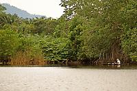 Fisherman in Los Micos Lagoon, Jeannette Kawas National Park, Punta Sal, Tela, Honduras.
