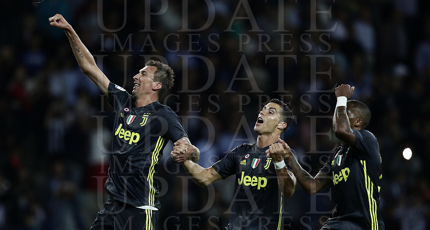 Calcio, Serie A: Parma - Juventus, Parma stadio Ennio Tardini, 1 settembre 2018.<br /> Juventus' Mario Mandzukic (l) Cristiano Ronaldo (c) and Douglas Costa (r) celebrate after winning 2-1 the Italian Serie A football match between Parma and Juventus at Parma's Ennio Tardini stadium, September 1, 2018. <br /> UPDATE IMAGES PRESS/Isabella Bonotto