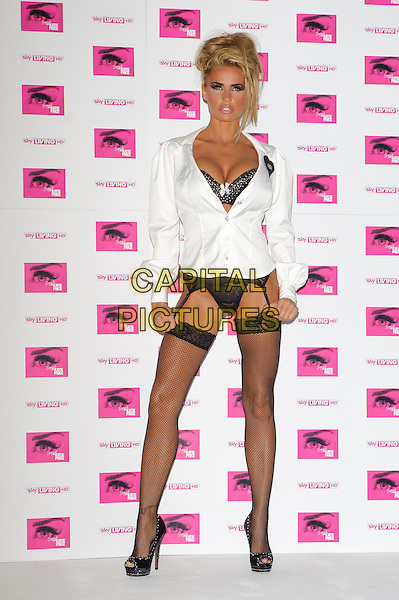 Katie Price (aka Jordan).promotes her new Sky Living series 'Signed By Katie Price' at The Worx, London, England 10th October 2011.full length white shirt unbuttoned bra peep toe shoes black cleavage hold ups garter belt stockings fishnet lace silver heart badge.CAP/CJ.©Chris Joseph/Capital Pictures.