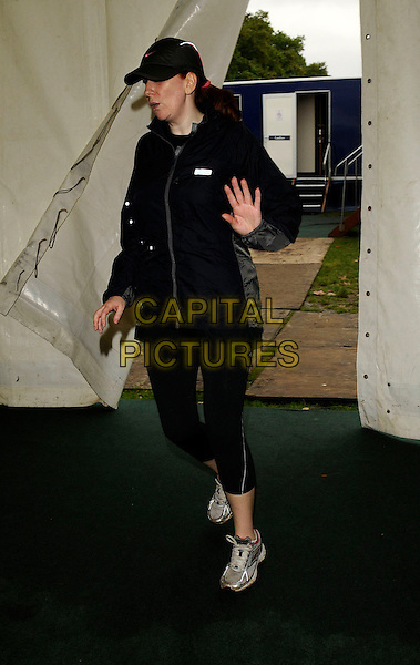 CATHERINE TATE.The Adidas Women's 5km Fun Run, Hyde Park, London, England..September 7th, 2008.full length black leggings jacket hat baseball cap hand .CAP/CAN.©Can Nguyen/Capital Pictures.