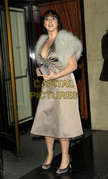 NATALIE CASSIDY.Arrivals - Laurence Olivier Awards at the Grosvenor Hotel, Park Lane, London, UK..February 18th, 2007.full length brown beige grey gray halterneck silk satin dress grwy white fur shrug wrap .CAP/CAN.©Can Nguyen/Capital Pictures