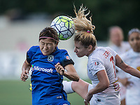 Seattle, WA - Saturday July 16, 2016: Nahomi Kawasumi, McCall Zerboni during a regular season National Women's Soccer League (NWSL) match between the Seattle Reign FC and the Western New York Flash at Memorial Stadium.