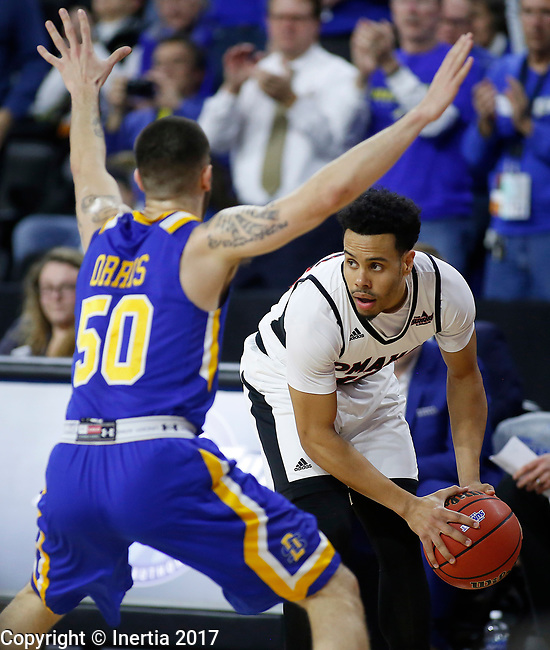 SIOUX FALLS, SD: MARCH 7: Daniel Norl #13 of Omaha looks past South Dakota State defender Michael Orris #50 during the Men's Summit League Basketball Championship Game on March 7, 2017 at the Denny Sanford Premier Center in Sioux Falls, SD. (Photo by Dick Carlson/Inertia)
