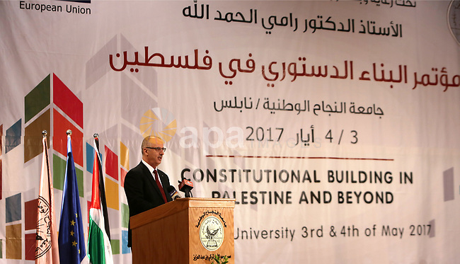 Palestinian Prime Minister Rami Hamdallah speaks during the conference of constitutional building in Palestine and beyond, at An-Najah national University in the West Bank city of Nablus on May 03, 2017. Photo by Prime Minister Office