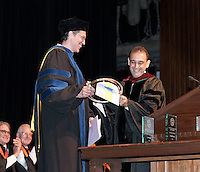 Dean of the College & Vice President for Academic Affairs Jorge  G. Gonzalez presents the Graham L. Sterling Memorial Award to Michael G. Hill, Professor of Chemistry. Occidental College Convocation ceremony on August 31, 2011 in Thorne Hall.  (Photo by Marc Campos, Occidental College Photographer)