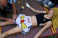 Lital Zastlin (lying down) gets a boxing oil rub by Shuki in preparation for her Muay Thai fight in Phigit..(please refer to emailed captions for individual stories)..Shuki Rosenweig brings five fighters to fight in Phigit, a town 3 hours north of Bangkok, on 1st February 2010. Lital, Ilya, Gil and two other fighters, one from France and another from Brazil..Photo by Suzanne Lee for Chabad Lubavitch