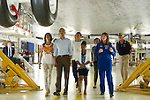 United States President Barack Obama holds hands with his daughter Malia as they walk under the space shuttle Atlantis with First Lady Michelle Obama, Sasha, and Marian Robinson during a tour they received of the NASA Orbital Processing Facility given by Astronaut, Janet Kavandi, and United Space Alliance project lead for thermal protection systems Terry White, right, at the NASA Kennedy Space Center in Cape Canaveral, Florida, Friday, April 29, 2011. .Mandatory Credit: Bill Ingalls / NASA via CNP