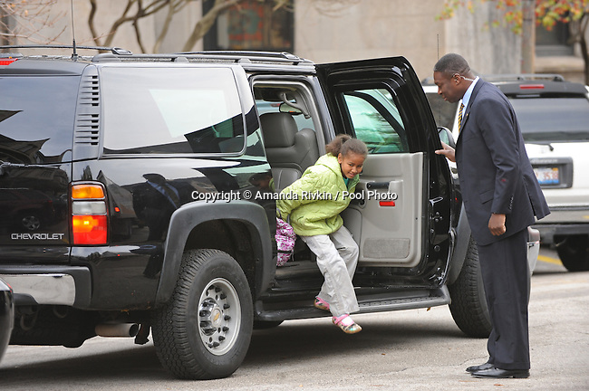 Sasha Obama, daughter of U.S. President Elect Barack Obama, gets dropped off for school at the University of Chicago Laboratory School with her sister Malia Obama as her dad waits in the car in Chicago, Illinois on Nov. 13, 2008.  Obama is working mostly in the Chicago area as he prepares for his transition to become the 44th U.S. President.