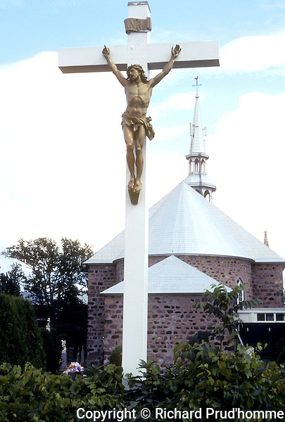 Crucifix behind the Saint Paul l'Hermite Church in Le Gardeur,Quebec