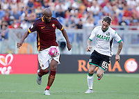 Calcio, Serie A: Roma vs Sassuolo. Roma, stadio Olimpico, 20 settembre 2015.<br /> Roma&rsquo;s Maicon, left, is chased by Sassuolo&rsquo;s Antonio Floro Flores during the Italian Serie A football match between Roma and Sassuolo at Rome's Olympic stadium, 20 September 2015.<br /> UPDATE IMAGES PRESS/Isabella Bonotto