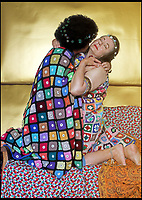 BNPS.co.uk (01202)558833<br /> Pic: AnnaGrayson/BNPS<br /> <br /> Gustav Klimt gets the treatment with Anna and her husband as the unlikely models.<br /> <br /> A photographer is taking the art world by storm with her modern take on the Old Masters - using her long suffering husband as a model.<br /> <br /> Anna Grayson's pastiche photos of greats like Leonardo Da Vinci, Jan Van Eyck and Botticelli are proving a hit with art fans and one of her works was even displayed at London's prestigious Royal Academy.<br /> <br /> Calling upon friends, family and fellow artist husband Des Maxwell Clark to serve as models, Grayson uses natural light and modern props including wigs, blankets, a selfie stick, a Barbie doll and even an inflatable hot tub for her unusual work.<br /> <br /> The quirky pictures will all seem vaguely familiar to anyone with a basic knowledge of famous art, but each has a modern twist - for example Van Eyck's Arnolfini couple are distracted on their mobile phones.<br /> <br /> Grayson has a collection of her work on permanent display at the Artizan Gallery in Torquay and a new exhibition opening at Words and Pictures Gallery in Teignmouth on May 26.