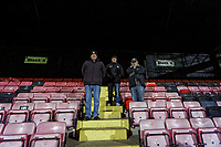 Pictured: Local supporters John Thomas (R) and Vincent Prout (C) watch training from the stand. Tuesday 20 February 2019<br /> Re: Neath RFC training at The Gnoll in Neath, south Wales, UK.