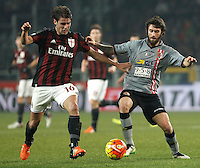 Calcio, quarti di finale di Coppa Italia: Alessandria vs Milan. Torino, stadio Olimpico, 26 gennaio 2016.<br /> AC Milan's Andrea Poli, left, and Alessandria's Simone Branca fight for the ball during the Italian Cup semifinal first leg football match between Alessandria and AC Milan at Turin's Olympic stadium, 26 January 2016.<br /> UPDATE IMAGES PRESS/Isabella Bonotto