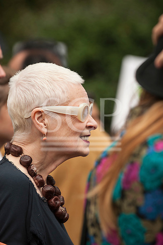 Designer Vivienne Westwood wears a necklace of horse chestnuts - conkers - as she marches in during the Climate Change demonstration, London, 21st September 2014. © Sue Cunningham