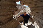 Yuval Peleg, Jordan Valley District Archaeologist at the Israel Antiquities Authority,<br /> explores a cave area in Qumran, near Dead Sea, Israel. <br /> June 8, 2009<br /> Photo by Ahikam Seri