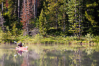 Kayakers on Pearl Lake as the mist rises off the lake, Pearl Lakes State Park, Clark, Colorado