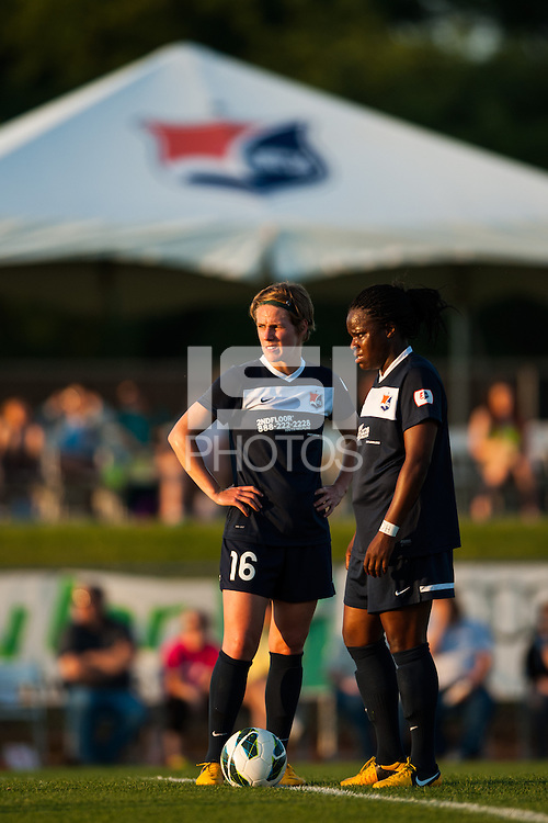 Sky Blue FC midfielder Sophie Schmidt (16) and forward Danesha Adams (9) talk. The Western New York Flash defeated Sky Blue FC 3-0 during a National Women's Soccer League (NWSL) match at Yurcak Field in Piscataway, NJ, on June 8, 2013.