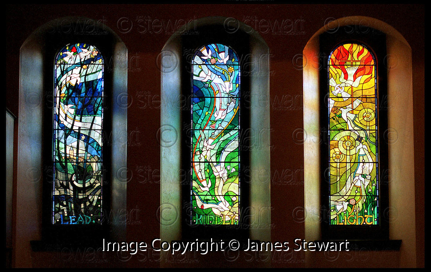 15th Dec 98        Ref : 980418.Copyright Pic : James Stewart   .THE THREE WINDOWS IN REMEMBERANCE OF THE DUNBLANE VICTIMS WHICH WERE INSTALLED AT THE HOLY FAMILY CATHOLIC CHURCH IN DUNBLANE....... THE WINDOWS REPRESENT THE CHILDREN BEING TAKEN FROM THE DARK INTO THE LIGHT....(see copy from Tim Bugler)......Payments to :-.James Stewart Photo Agency, Stewart House, Stewart Road, Falkirk. FK2 7AS      Vat Reg No. 607 6932 25.Office : 01324 630007        Mobile : 0421 416997.E-mail : JSpics@aol.com.If you require further information then contact Jim Stewart on any of the numbers above.........