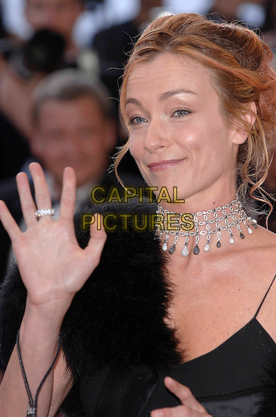 """GUEST.""""Star Wars : Episode III - Revenge of the Sith"""" screening.58th International Cannes Film Festival, France.15 May 2005.Ref: PL.premiere headshot portrait waving gesture palm hand choker necklace.www.capitalpictures.com.sales@capitalpictures.com.©Capital Pictures."""