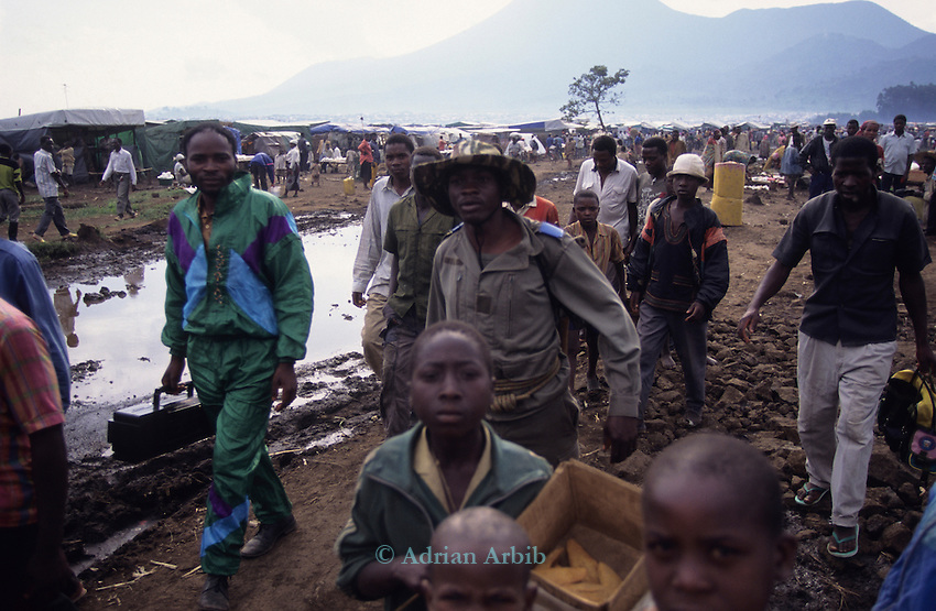 Hutu men in Kibumba  camp in 1995, Goma, Zaire. The immediate area was filled with 100's of thousands of Hutu refugees fleeing from the war in neighbouring Rwanda.