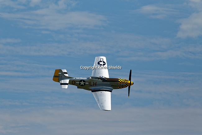 North American Aviation P-51 Mustand fighter aircraft flying at an airshow, Owls Head, Maine, USA