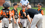WATERBURY, CT-0712117JS06--Water-Oak coach Tim Angiolini talks with his players during their consolation bracket game against the Bonnies of Brooklyn, in the Roberto Clemente Tournament Thursday at the Waterbury PAL field. <br /> Jim Shannon Republican-American