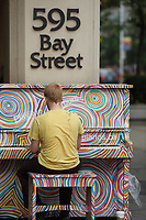 Toronto (ON) CANADA - July 2012 - A stranger play the piano  in downtown Toronto . <br />