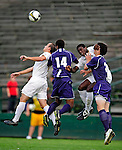 11 September 2009: University of Vermont Catamount forward D.J. Edler (right), a Freshman from Atlanta, GA, and midfielder/backfielder Rem Kielman (left), a Junior from Hinesburg, VT, jump for the ball against the University of Portland Pilots, in the first round of the 2009 Morgan Stanley Smith Barney Soccer Classic held at Centennial Field in Burlington, Vermont. The Catamounts and Pilots battled to a 1-1 double-overtime tie. Mandatory Photo Credit: Ed Wolfstein Photo