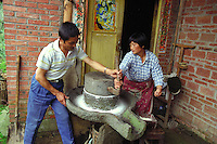 Farmers processing soja for Tofu Production