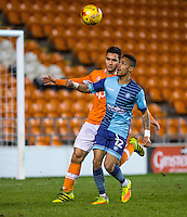 Paris Cowan-Hall of Wycombe Wanderers holds off Sebastien Des Pres of Blackpool during the The Checkatrade Trophy match between Blackpool and Wycombe Wanderers at Bloomfield Road, Blackpool, England on 10 January 2017. Photo by Andy Rowland / PRiME Media Images.