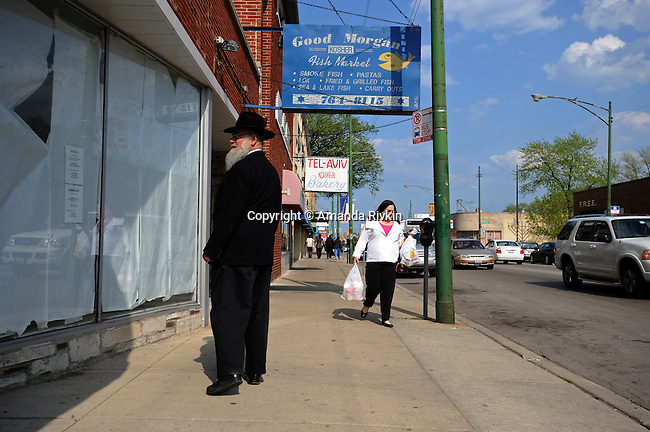 An Orthodox Jewish man and a woman in the Jewish section of Devon Avenue near Richmond Avenue in Chicago, Illinois on May 5, 2008.  Indian, Pakistani, Muslim and Jewish, Devon Avenue in the West Rogers Park neighborhood is an eclectic representation of the world.