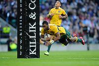 Tevita Kuridrani of Australia dives over to score a try during the Killik Cup match between Barbarians and Australia at Twickenham Stadium on Saturday 1st November 2014 (Photo by Rob Munro)