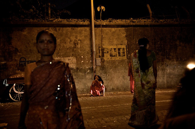 Sex workers wait for business in Hanuman Galli, a red light area in Worli, South Mumbai.