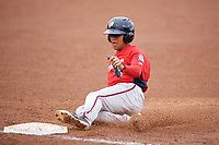 Potomac Nationals center fielder Blake Perkins (22) slides into third base during the first game of a doubleheader against the Salem Red Sox on June 11, 2018 at Haley Toyota Field in Salem, Virginia.  Potomac defeated Salem 9-4.  (Mike Janes/Four Seam Images)