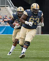 Pitt guard Alex Officer (63) blocks for running back Darrin Hall. The Pitt Panthers defeated the Youngstown State Penguins 28-21 in overtime at Heinz Field, Pittsburgh, Pennsylvania on September 02, 2017.
